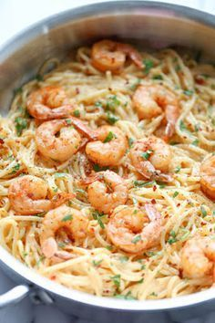 Garlic Shrimp Alfredo Pasta - a simple 35 minute dinner. Shrimp is cooked in butter and lots of garlic then combined with a homemade, very creamy 4 cheese Italian pasta sauce! Fish Recipes, Seafood Recipes, Dinner Recipes, Cooking Recipes, Recipies, Seafood Pasta, Easy Shrimp Pasta Recipes, Yummy Recipes, Four Cheese Pasta