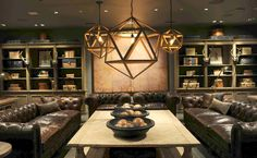 Restoration Hardware does it a little too symmetrically. The lighting is interesting, looks like a stage set.