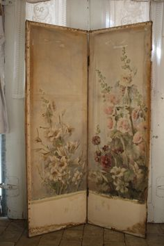 Easy to DIY with special oversize prints aged to perfection then wallpapered to plywood sheets, hinged.