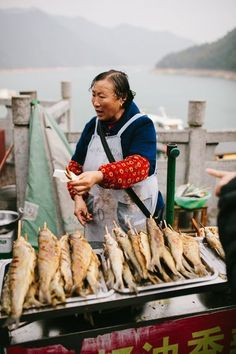 Woman selling fish, China - street food around the world