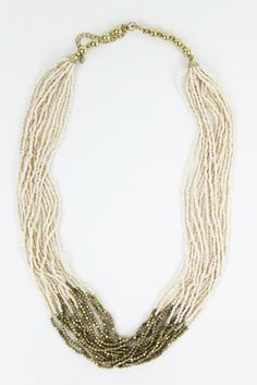 Gold Dip Beaded Layer Necklace. Love the cream and gold combo! $24