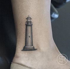 Small Lighthouse Tattoo on Ankle by Sven Rayen