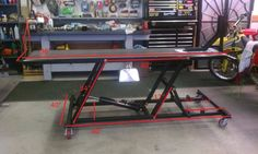 Motorcycle Lift Table by Zukbox II -- Homemade motorcycle lift table constructed from tubing, steel sleeves, steel plate, nuts, bolts, casters, and a hydraulic cylinder. http://www.homemadetools.net/homemade-motorcycle-lift-table-10
