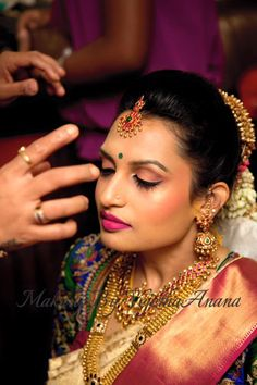 Traditional Southern Indian bride, Akshaya wears bridal silk saree and jewellery for her Muhuratam. Makeup and hairstyle by Vejetha for Swank Studio. Berry lips. Eye makeup. Maang tikka. Silk sari. Tamil bride. Telugu bride. Kannada bride. Hindu bride. Malayalee bride. Bridal Saree Blouse Design. Indian Bridal Makeup. Indian Bride. Gold Jewellery. Statement Blouse.  Find us at https://www.facebook.com/SwankStudioBangalore