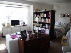 studio apartment separate bed with bookcase