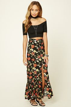 A woven maxi skirt featuring an allover floral print, a button-down front that leads into a center-front slit, and an asymmetrical shirred hem.