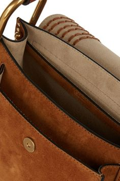 Tan suede (Calf) Snap-fastening front flap Designer color: Caramel Comes with dust bag Weighs approximately 1.5lbs/ 0.7kg Made in Italy