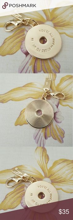 """NWOT Justin Bieber Record Charm This Justin Bieber charm has """"You're All That Matters To Me- JB"""" engraved on the record charm.  It also has a smaller square charm with initials and a clasp that opens and closes to add to a necklace, bracelet, purse or key ring. Jewelry"""