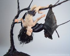 """""""Bat Fairy Kissing a Bat Friend"""" by artist Daniela Messina, sculpted in polymer clay without the use of molds.  See her website here:  http://www.celidoniastudio.blogspot.it/"""