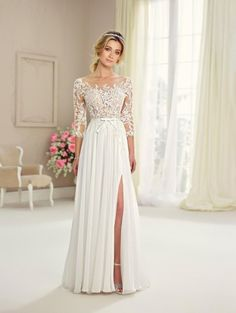 Style 217108 from Enchanting by Mon Cheri is an A-line informal wedding gown in chiffon, tulle and lace with lace three-quarter length sleeves, a bow embellished waistline, a deep scoop back, a chiffon skirt with side slit, and chapel length train.