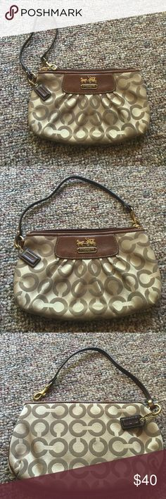 💕Coach Zip Wristlet💕 Beautiful Coach Wristlet with pink interior! Has a small dirt stain on the back but other then that it's perfect! Coach Bags Clutches & Wristlets