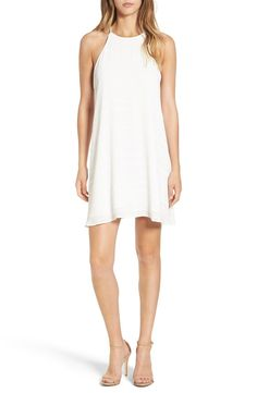 Loving this classic white dress with a high neckline for a chic look.