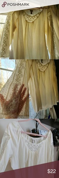 Pretty lacey hippy top Cream/ Ivory gauzy material with gorgeous detailed lace on arms and embroidered lace on front top..also small border of lace on bottom..I love this top and will be sad to see it go but would love for someone to enjoy it just as much as I did...worn only a few times and always received compliments...excellent condition..perfect for spring/summer/fall festivals..18/20..True to size. Smoke free home. Lane Bryant Tops Blouses