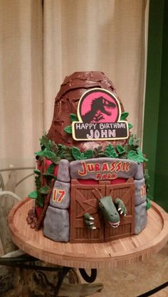 Jurassic Park Volcano Cake. Dry ice, marshmallow fluff (heat in microwave until runny), hot water used for the lava. We added sparklers on top for the candles.