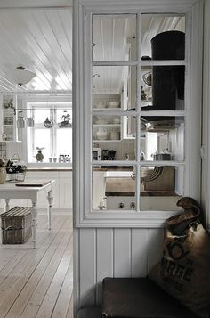 great use of old window....love it! notice also fab treatment of painting wooden floor And ceiling in white!!! notice white painted kitchen work table too!!! looove