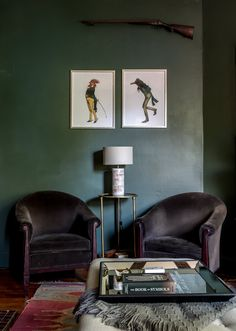 """The vintage club chairs are some of the favorite seats in the room. The prints above are from """"The Granville Series"""" courtesy of Triple Stamp Press, a local printing company. Gold leaf table is from HomeGoods, lamp on top from Horchow."""