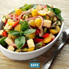 A 30 minute salad of bright Mediterranean summer vegetables tossed together in a light vinaigrette with feta cheese and basil.