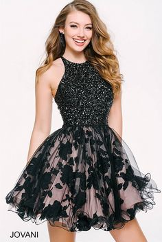 Jovani party dress with black beaded halter top and black floral pattern skirt. #JovaniCollection