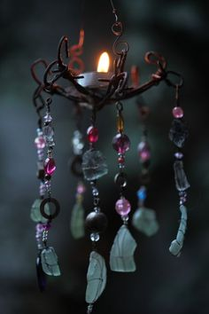 I love wind chimes and all sorts of hanging objects in my garden. Like this little candle holder.
