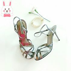 🐰Trending: Metallics! Ziggy NY Strappy Sandals Metallic means jewelry for your feet!  Approx. 3in. heels, adjustable ankle strap and sexy with everything. All silver with adjustable ankle strap and one pewter strap woven through the shoes. Add the metallic trend to jeans or dress up an LBD. POP?? you're IT! All man made material??Worn only during try-on! **Ask questions B4 U Buy!!** ZIGI New York Shoes Heels