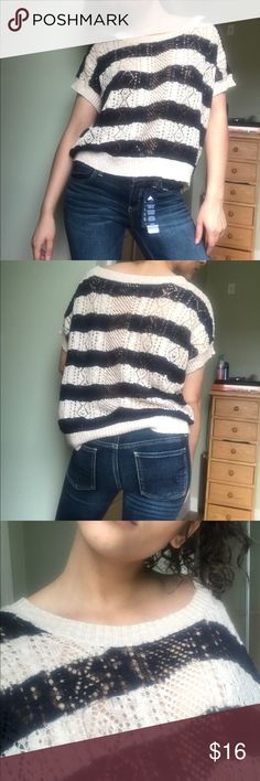 Medium Navy and Beige striped knit shirt A cute and light navy and beige shirt, got this in Japan. It's just not my style anymore. Tops Sweatshirts & Hoodies