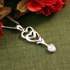 """Our Welsh love spoon necklace is the perfect gift of affection. The Welsh custom of giving love spoons as a token of affection began in Wales in the 16th Century. Love spoons were given to the one you loved as a gift during courting. In the old days in Wales, young men would carve an intricate spoon in wood to give to his girl during courtship. The expression """"to spoon"""" comes from this welsh love spoon custom. Each carved symbol had a meaning such as hearts for love. Today love spoons are…"""