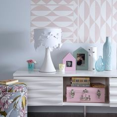 Pastel bedroom storage  The words 'bedroom storage' need not conjure up images of boring side tables. Choose statement units such as this one, which doubles as a display space; the modern design is complemented by the wallpaper squares on the wall behind it.