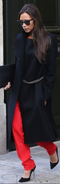 Who made  Victoria Beckham's chain coat, black sunglasses, snake clutch, and suede pumps?