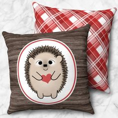 """Home decor for your inner happy! Rustic Hedgehog with Heart on Wood Red Plaid Faux Suede Pillow is the #homedecor to have in your home. A cute square throw pillow with an adorable hedgehog holding a red heart in white oval outlined in red, over a rustic brown wood illustrated background. The backside of the pillow is a red plaid pattern to compliment the red on the front. The cover is an animal-friendly soft microfiber material and is available in 14"""" x 14"""", 16"""" x 16"""", 18"""" x 18"""", and 20"""" x…"""
