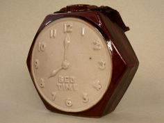 'The Bed time' stoneware hot water bottle in the form of a hexagonal –cased clock c1930