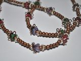 Love the copper beads and little flower shapes, Beautiful!  Would make a cute wrap braclet too.