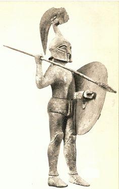Escultura de soldado etrusco de bronce.