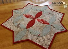 Winter Seeds Table Topper Free Tutorial. Seeds are appliqued to 4-patch units of Charm squares, Fusible web secures it around the edge of the applique. PDF seed template to download.