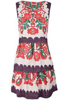 Apricot Sleeveless Floral Cascading Ruffle Dress.