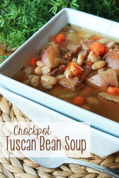 Crockpot Tuscan Bean Soup - Red bliss potatoes slow cooked with carrots, garlic, onion, Great Northern beans, and ham for this amazing soup!