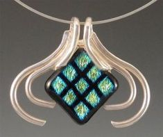 The Jacket metal clay and fused glass pendant by Arlene Mornick, from Dress Up Your Glass: 5 Tips for Making Metal Clay and Fused Glass Jewelry from Arlene Mornick