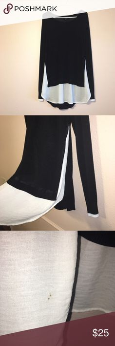 Black Paneled Sweater a.n.a black and white paneled sweater. With a black knit and white chiffon this sweater is so comfy. Pair with leggings and you have the prefect outfit to cozy up by the fire in. a.n.a Sweaters Crew & Scoop Necks