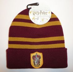 1fcdccf93334b This is a very nice knit striped beanie hat. The cuff features a Gryffindor  patch on the front. Keep warm in the winter!
