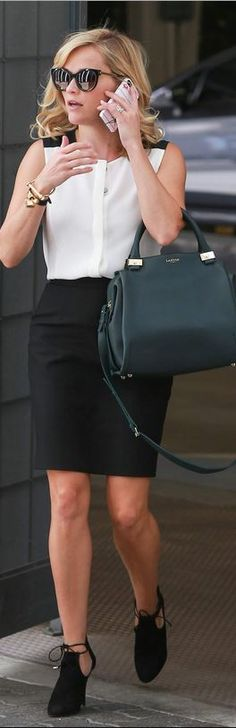 Who made Reese Witherspoon's black sunglasses, black suede cut out ankle boots, and green handbag?