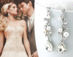 """Bridal Earrings Wedding Earrings Wedding by goddessdesignsgems, $40.00 """"Sooo fabulous…these earrings are """"amazingly beautiful"""" and are sure to make a statement! Very unique drop style earrings, designer inspired design encrusted with clear glistening Austrian crystals interspersed with lustrous white pearls finished with large pear shaped crystal. Earrings are """"silver"""" plated and measure approx 2 3/4"""" in length."""