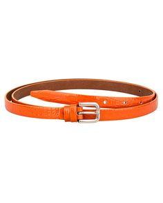 Find a way to your ideal body shape with the Crocodile orange skinny belt. With a width of just 14 mm, this limited edition skinny women's belt will surely give you're the form that you want for your dress or office get up. The orange color gives it a friendly, hip vibe. The crocodile emboss leather design is a testament of its craftsmanship. Every woman must have this in her closet. Have your own today.