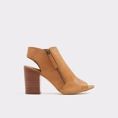Manuella These peep toe sling back sandals bring fashion to the forefront with their chunky heel and leather tops. Be sure to show these beauties off in your ankle length jeans.