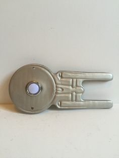 Just a simple doorbell. Made from sturdy resin, this wired doorbell is in the shape of the Star Trek Enterprise. Painted silver and sealed, this doorbell could go horizontally or vertically. Doorbells, Star Trek Enterprise, Handsome Man, Etsy Shop, Stars, Silver, Accessories, Man Candy Monday, Sterne