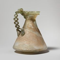 Glass jug with chain handle Period: Late Imperial Date: 3rd century A.D. Culture: Roman Medium: Glass; blown in a dip-mold and trailed