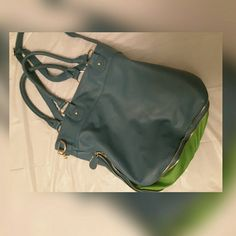 Neon lights crossbody bag Gently used bag. Does have wear and tare on the handles. it's still in great condition. Has plenty of life left in it. Has a stain on bottom of bag (shown in 2nd photo) but bottom part can zip up so no one can see it. Ask for?'s. Deux Lux Bags Crossbody Bags