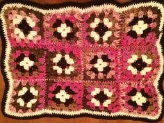Granny square mini blanket for my grandbaby. She wears it like a cape!!!