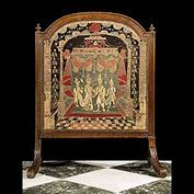 An oak framed firescreen in the Baroque manner. The 18th century tapestry panel depicts Eastern Royal Couple attended by two Pages, with a marquee in the background. Photo before restoration. English,