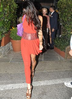 Fashion sense: Tala looked stunning in the outfit featuring one pant leg and a short skirt. Ellen Barkin, who was at George and Amal's wedding last year, followed behind