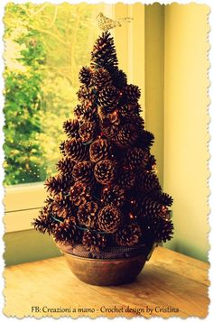 Pine cone tree - spiral Styrofoam, hot glue.  I think the white base should be painted brown first.