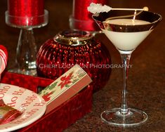 Creme Brulee Martini with Vanilla Vodka, Licor 43, Heavy Whipping Cream and rock candy garnish. Excellent dessert style cocktail for your holiday glass.